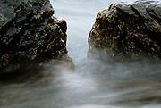 Waves crashing over rocks along the New Hampshire USA coast.