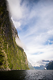 NEW ZEALAND, Fiordland National Park, Cruise Ship below the Cliffs of Milford Sound, Ben M Thomas