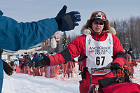 Harry Alexie team leaves the start line during the restart day of Iditarod 2009 in Willow, Alaska