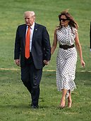 United States President Donald J. Trump and First lady Melania Trump hold hands as they walk on the South Lawn of the White House in Washington, DC after delivering remarks at the Prescription Drug Abuse and Heroin Summit in Atlanta, Georgia on April 24, 2019.<br /> Credit: Ron Sachs / CNP