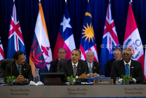 United States President Barack Obama, center, makes remarks as he meets with Trans-Pacific Partnership leaders at the Hale Koa Hotel in Honolulu, Hawaii on Saturday, November 12, 2011.  At left is Hassanal Bolkiah, the Sultan of Brunei, and at right is U.S. Trade Representative Ron Kirk..Credit: Kent Nishimura / Pool via CNP