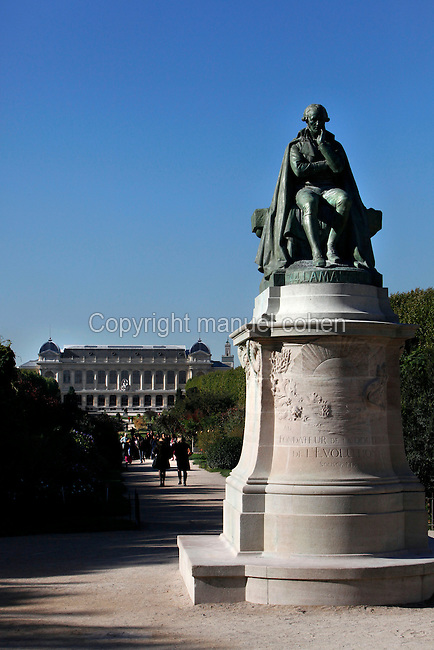 General view of the statue of Jean-Baptiste Pierre Antoine de Monet, Chevalier de la Marck, known as Lamarck, created by Leon Fagel in 1908 and located at the entrance of Carres de la perpective (the plots of Perspective), Valhubert Place, in the Jardin des Plantes, Paris, 5th arrondissement, France. In the distance can be seen the Grande Galerie de l'Evolution (Great Gallery of Evolution). Founded in 1626 by Guy de La Brosse, Louis XIII's physician, the Jardin des Plantes, originally known as the Jardin du Roi, opened to the public in 1640. It became the Museum National d'Histoire Naturelle in 1793 during the French Revolution. Picture by Manuel Cohen