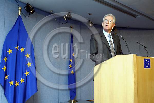 BRUSSELS - BELGIUM - 24 MARCH 2004-- Mario MONTI the Italian EU-Commissioner for Competition announcing the EU-Commission conclusion on the Microsoft investigation. -- The EU-Commission declared Microsoft Corporation guilty of abusing its near monopoly with Windows to foil competitors in other markets and hit the software giant with a record fine of 497.2 million EUR and ordered it to offer a European version of its Windows operating system without the Media Player. -- PHOTO: JUHA ROININEN / EUP-IMAGES