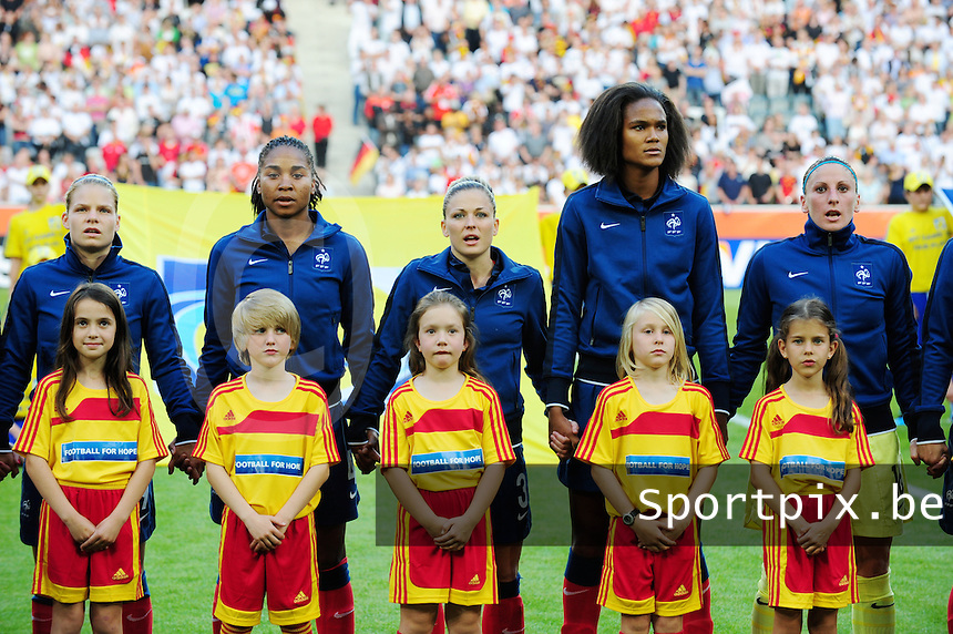 Fifa Women's World Cup Germany 2011 : France - Germany ( Frankrijk - Duitsland ) at Munchengladbach World Cup stadium : Eugenie LE SOMMER , Laura GEORGES , Laure BOULLEAU en Wendie RENARD en Berangere SAPOWICZ  .foto DAVID CATRY / Vrouwenteam.be
