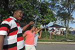 (L-r) Vincent Dixon, 13, Vashanae Dixon, 9, and Va'Quon Banks, 11, sing in prayer outside Michael Jackson's boyhood home, the morning after news of his death at a Los Angeles hospital went around the world, at 2300 Jackson Street in Gary, Indiana on June 26, 2009.