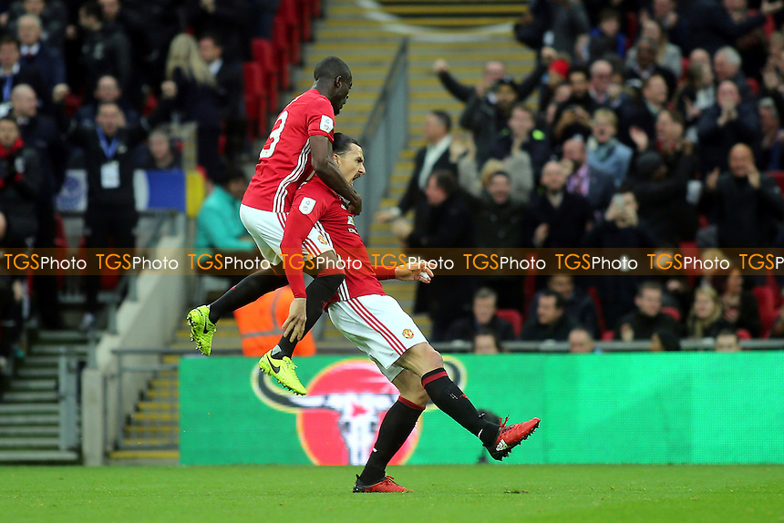 Zlatan Ibrahimovic celebrates scoring Manchester United's opening goal as Eric Bailly leaps on his back during Manchester United vs Southampton, EFL Cup Final Football at Wembley Stadium on 26th February 2017