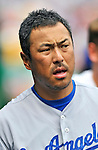 5 September 2011: Los Angeles Dodgers pitcher Hiroki Kuroda awaits the start of play in the dugout prior to a game against the Washington Nationals at Nationals Park in Los Angeles, District of Columbia. The Nationals defeated the Dodgers 7-2 in the first game of their 4-game series. Mandatory Credit: Ed Wolfstein Photo