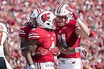 Wisconsin Badgers wide receiver A.J. Taylor (4) celebrates a touchdown with teammates during an NCAA Big Ten Conference football game against the Maryland Terrapins Saturday, October 21, 2017, in Madison, Wis. The Badgers won 38-13. (Photo by David Stluka)