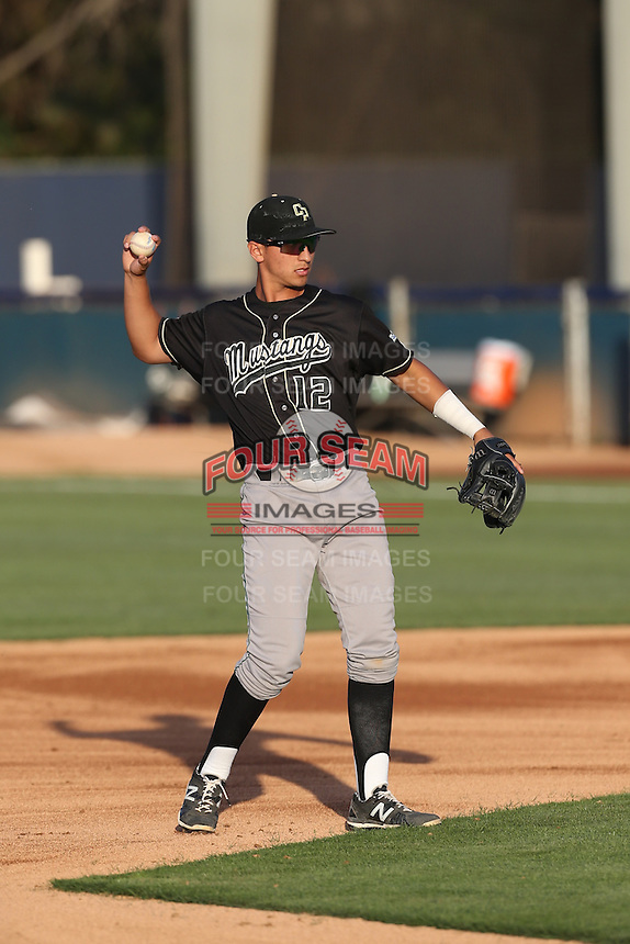 Mark Mathias (12) of the Cal Poly Mustangs in the field during a game against the Cal State Fullerton Titans at Goodwin Field on April 2, 2015 in Fullerton, California. Cal Poly defeated Cal State Fullerton, 5-0. (Larry Goren/Four Seam Images)