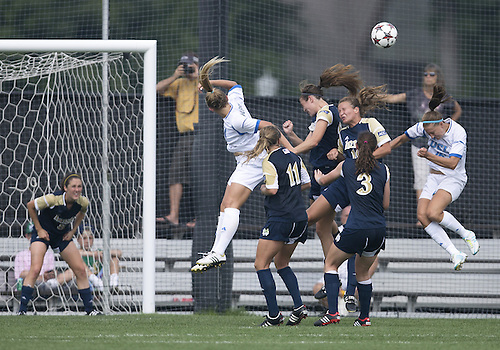 September 01, 2013:  Players go up for the ball during NCAA Soccer match between the Notre Dame Fighting Irish and the UCLA Bruins at Alumni Stadium in South Bend, Indiana.  UCLA defeated Notre Dame 1-0.