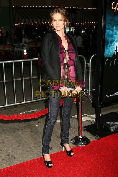 "CHARLIZE THERON.""The Reaping"" Los Angeles Premiere at Mann's Village Theatre, Hollywood, California, USA, 29 March 2007..Full length skinny jeans black jacket.CAP/ADM/BP.©Byron Purvis/AdMedia/Capital Pictures."