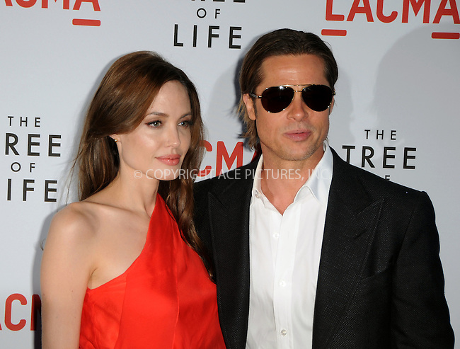 WWW.ACEPIXS.COM . . . . .  ....May 24 2011, Los Angeles....Actors Angelina Jolie and Brad Pitt arriving at the premiere of  'The Tree of Life' at the Bing Theatre at the Los Angeles County Museum of Art on May 24, 2011 in Los Angeles, California....Please byline: PETER WEST - ACE PICTURES.... *** ***..Ace Pictures, Inc:  ..Philip Vaughan (212) 243-8787 or (646) 679 0430..e-mail: info@acepixs.com..web: http://www.acepixs.com