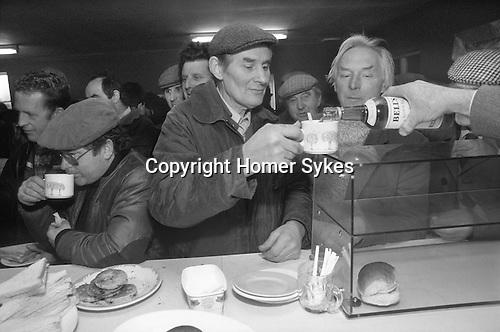 "Farmers enjoy a drink of tea and whisky at the Farmers ""Christmas Market"", Knighton, Shropshire Circa 1985"