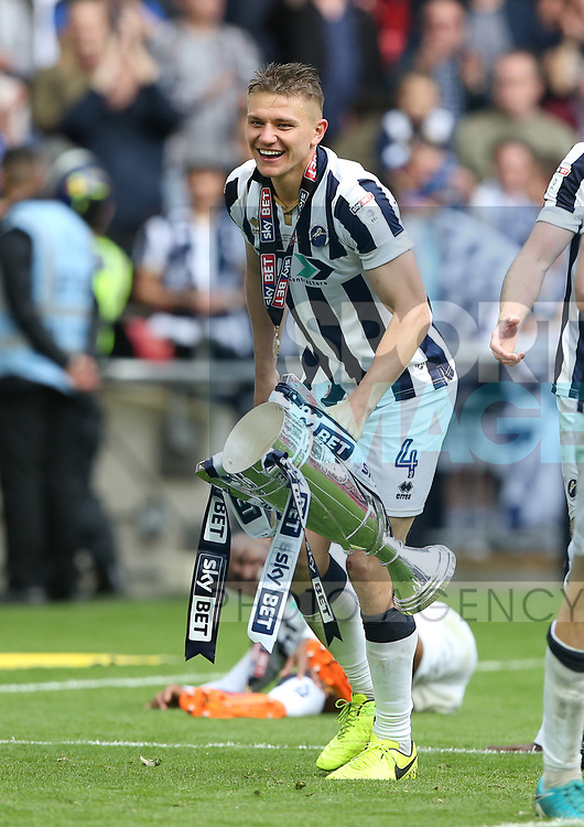 Millwall's Shaun Hutchinson celebrates with the trophy during the League One Play-Off Final match at Wembley Stadium, London. Picture date: May 20th, 2017. Pic credit should read: David Klein/Sportimage