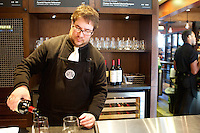 10/17/10 3:17:47 PM -- Seattle, WA, U.S.A - Barista Supervisor Casey O'Neill serves up wine that wine bar in the newly remodeled Starbucks in Seattle. Starbucks is now offering wine, beer and dinner fare at their stores.