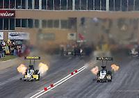 Jul. 19, 2014; Morrison, CO, USA; NHRA top fuel driver Khalid Albalooshi (right) alongside Richie Crampton during qualifying for the Mile High Nationals at Bandimere Speedway. Mandatory Credit: Mark J. Rebilas-