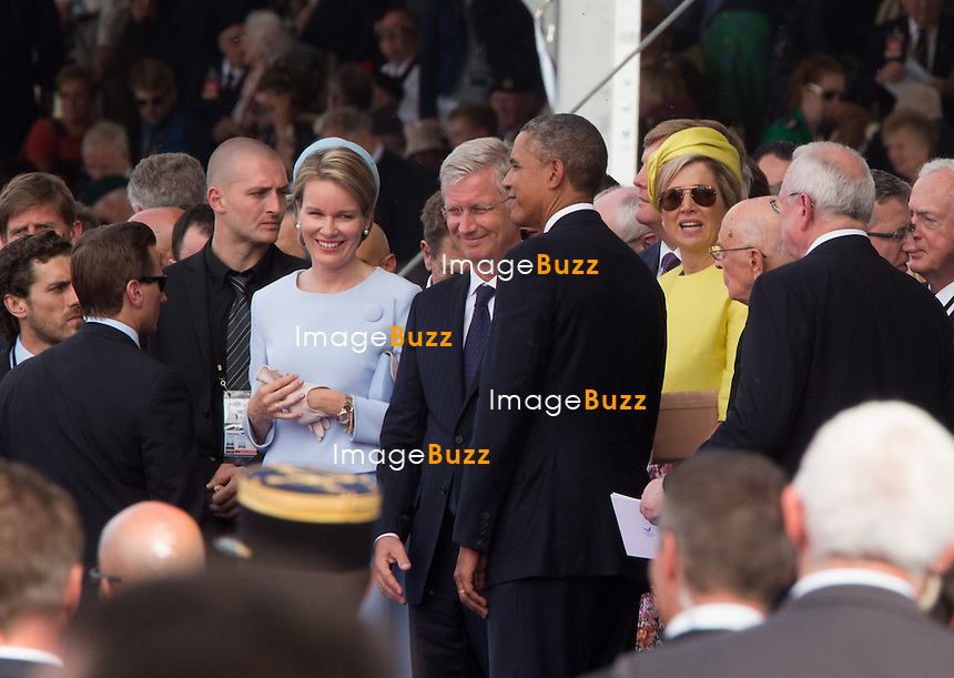 QUEEN MATHILDE OF BELGIUM, KING PHILIPPE PHILIPPE OF BELGIUM, BARACK OBAMA, QUEEN MAXIMA OF THE NETHERLANDS, GIORGIO NAPOLITANO - 70th Anniversary Of The Liberation - International Ceremony in Ouistreham, France. with Fran&ccedil;ois Hollande, President of the French Republic, Prime Minister, Barack Obama, Queen Elizabeth II, King Philippe of Belgium, Angela Merkel, Grand Duke of Luxembourg, Henri, King Willem-Alexander of the Netherlands, King Harald V of Norway, Vladimir Putin, Tony Abbott ; Prime Minister of Australia, Stephen Harper ; Prime Minister of Canada, Milos Zeman ; President of the Czech Republic, Queen of Danemark ; Margrethe II, Karolos Papoulias ; President of the Hellenic Republic, Giorgio Napolitano ; President of the Italian Republic, Jerry Mateparae ; Governor-General of New-Zealand, Bronislaw Komorowski ; President of the Republic of Poland, Ivan Gasparovic ; President of the Slovak Republic, Queen Mathilde of Belgium, Prince Albert II of Monaco, Prince Charles, Prince Philip, Camilla, Duchess of Cornwall, Herman Van Rompuy, Elio Di Rupo, Maria Teresa of Luxembourg, Queen Maxima of the Netherlands, David Cameron, Grand Duke Jean of Luxembourg, Erna Solberg, Prime Minister of Norway.<br /> France, Ouistreham, June 6, 2014.<br /> 70&egrave;me Anniversaire de la Lib&eacute;ration en Normandie - C&eacute;r&eacute;monie Internationale &agrave; Ouistreham, en pr&eacute;sence de Fran&ccedil;ois Hollande, Pr&eacute;sident de la R&eacute;publique fran&ccedil;aise, du Premier ministre et de tous les les chefs de d&eacute;l&eacute;gation.<br /> France, Ouistreham, 6 juin 2014.