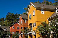 Colorful stucco homes are shown in Charlotte, NC.