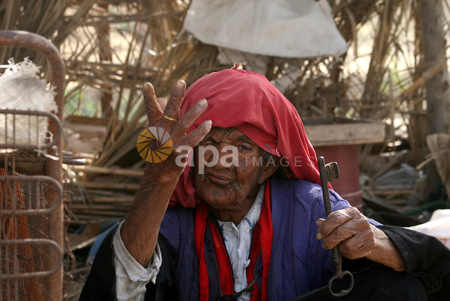 A Palestinian refugee elderly woman Om Adnan, 95, from bedouin clan central Gaza Strip, displays her home Key in the Arab village of Ber El-Sabaa which occupied by Israel in 1948.  As Israel celebrates its 60th anniversary, Palestinians commemorate the Nakba, the expulsion of some 700,000 people during the 1948 war, an event that for them is the core of the decades-old Middle East conflict.