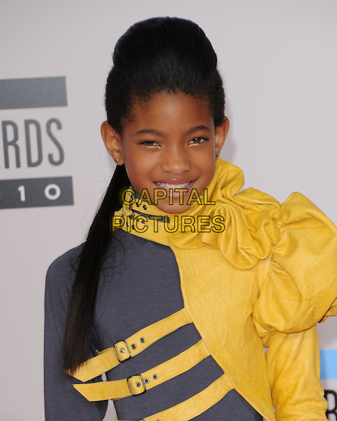 WILLOW SMITH .At The 2010 American Music  Awards held at Nokia Theatre L.A. Live in Los Angeles, California, USA,.November 21st 2010..amas arrivals portrait headshot  grey gray  yellow sleeve buckles ruched puffy  eyeliner make-up hair smiling beauty.CAP/RKE/DVS.©DVS/RockinExposures/Capital Pictures.