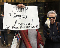 NEW YORK, NY - NOVEMBER 4:  Anti-Trump protestor and woman holding Donald Trump voodoo dolls protest outside of Trump Tower in New York, New York on November 2, 2016.  Photo Credit: Rainmaker Photo/MediaPunch