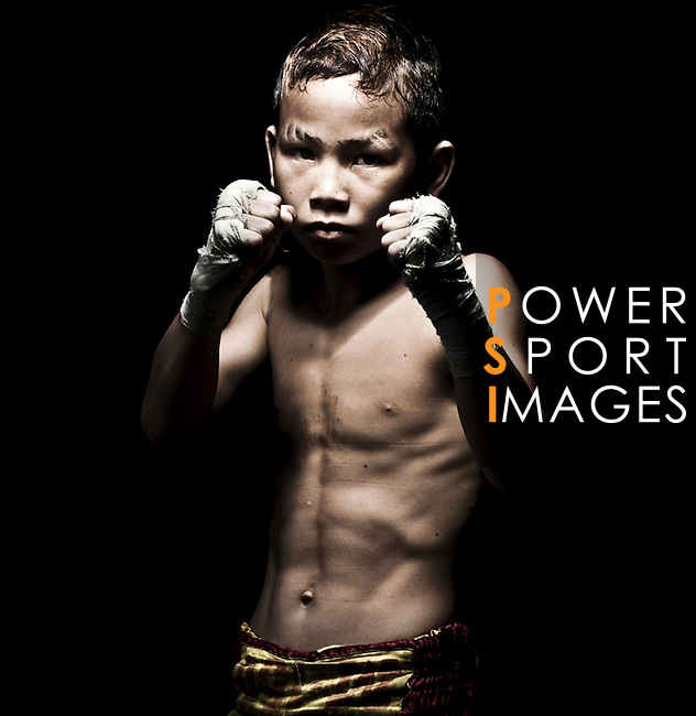 """Muay Thai Kickboxing figther Suwanaked at Sangmorakot gym in Bangkok, Thailand. Muay Thai, also know as """"Art of Eight Limbs"""", is a hard martial art and Thailand's national sport. Photo by Victor Fraile --- Image by © Victor Fraile"""