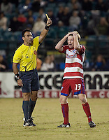 Dax McCarty is issued a yellow card.  FC Dallas defeated the San Jose Earthquakes 2-1 at Buck Shaw Stadium in Santa Clara, California on October 7, 2009.