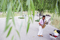 A man plays a saxophone in Changle Park in Xian, Shaanxi Province, China.