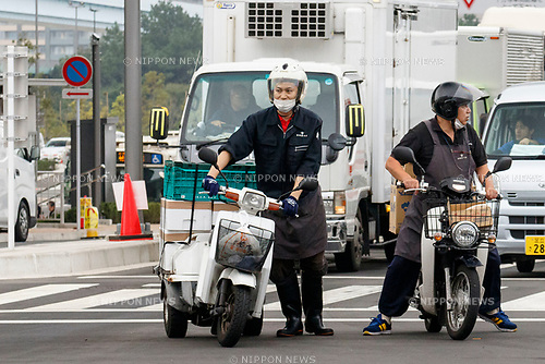 Workers transport merchandise at the new Tokyo Metropolitan Central Wholesale Market which opened in Toyosu on October 11, 2018, Tokyo, Japan. The new fish market replaces the famous Tsukiji Fish Market which closed for the last time on Saturday 6th October. The move to Toyosu was delayed for almost 2 years because of fears over toxins found in water below the new market. (Photo by Rodrigo Reyes Marin/AFLO)