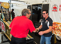 Oct 15, 2016; Ennis, TX, USA; Papa Johns Pizza owner John Schnatter (right) greets NHRA team owner Don Schumacher during the Fall Nationals at Texas Motorplex. Mandatory Credit: Mark J. Rebilas-USA TODAY Sports