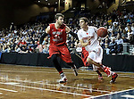 SIOUX FALLS, SD - MARCH 15: Tanner Kretchman #3 from Minnesota State University Moorhead drives against Dillon Deck #24 from Central Missouri in the second half of their NCAA Regional game Sunday evening at the Sanford Pentagon in Sioux Falls, SD.  (Photo by Dave Eggen/Inertia)