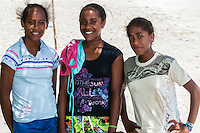 Kanak (Melanesian) girls on beach at Mebuet, island of Mare, Loyalty Islands, New Caledonia