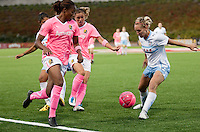 Kandace Wilson (left) runs for the pass from Camile Abily (center) against Natalie Spilger (right). FC Gold Pride tied the Chicago Red Stars 0-0 in PUMA's Project Pink, Think Pink, Breast Cancer Awareness game at Pioneer Stadium in Hayward, California on August 7th, 2010.