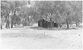 View of the Embudo pumphouse from across the track.<br /> D&amp;RGW  Embudo, NM  Taken by Rogers, Donald E. A. - 5/24/1939