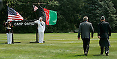 U.S. President George W. Bush (L) and Afghan President Hamid Karzai walk together after holding a joint press conference in Camp David Maryland, USA on Monday 06 August 2007. Karzai's two-day visit to the Presidential mountain retreat included discussions of trouble at home, including a hostage crisis and a resurgent Taliban.