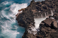 Rough surf off rocky Maui, Hawaii coastline.