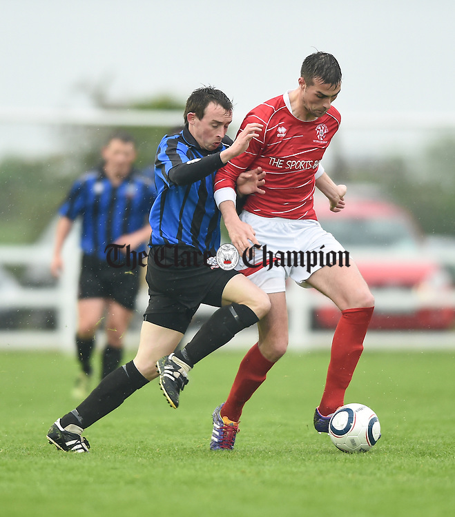 Derek Fahy of Bridge United in action against Paddy Purcell of Newmarket Celtic during their Cup final at Doora. Photograph by John Kelly.