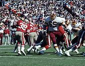 Washington Redskins defensive tackle Dave Butz (54) pursues San Francisco Forty-Niner running back Johnny Davis (38) during the game at RKK Stadium in Washington, D.C. on October 4, 1981.  The 49ers won the game 30 - 17.<br /> Credit: Howard L. Sachs / CNP