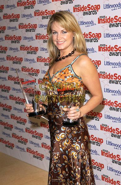 KIM MEDCALF.Inside Soap Awards 2005, Floridita London, W1..September 26th, 2005.half length Metcal award trophy brown silk satin pattern dress.www.capitalpictures.com.sales@capitalpictures.com.© Capital Pictures.