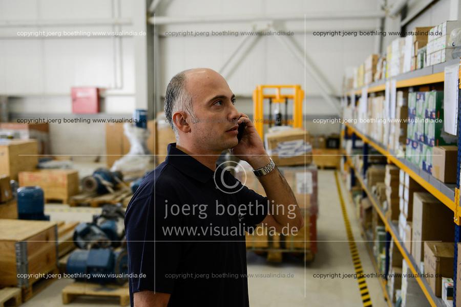 TURKEY Izmir, service point of Nordex wind energy, store  / TUERKEI Izmir, Service Betrieb von Nordex Tuerkei, Ersatzteil-Lager, Mitarbeiter Ali Karaali