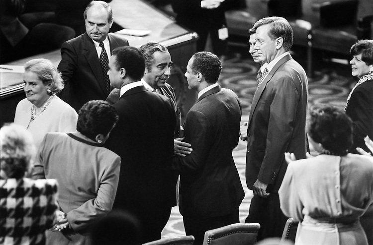 "Rep. Charles Bernard ""Charlie"" Rangel, D- N.Y., greets Rep. Alphonso Michael ""Mike"" Espy, D- Miss., on the floor of the House of Representatives. Also in picture: Sec. Ronald Harmon ""Ron"" Brown, D- Croatia, Secretary of Commerce, Sec. Madeleine Jana Korbel Albright, Secretary of State, Sec. Donna Edna Shalala, Secretary of Health and Human Services, Sec. Michael ""Mickey"" Kantor, Secretary of Commerce and Sec. Bruce Edward Babbitt, Secretary of the Interior. October 10, 1994 (Photo by Laura Patterson/CQ Roll Call)"