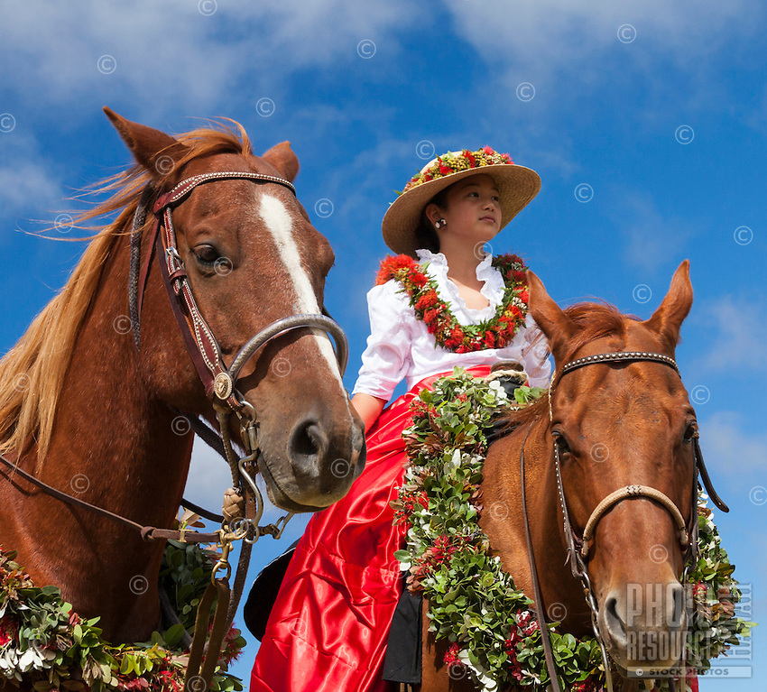 A young pa'u rider waits for the start of the Waimea Paniolo Parade, Big Island.