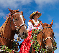 A young pa'u rider waits for the start of the Waimea Paniolo Parade, Big Island.