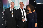 © Joel Goodman - 07973 332324 . 03/03/2016 . Manchester , UK . Michael Hardacre , president of Manchester Law Society , Team of the Year winner - Regulatory , IAN LEWIS (obo LHS Solicitors ) (centre) . The Manchester Legal Awards from the Midland Hotel . Photo credit : Joel Goodman