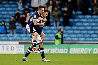 Shaun Williams leaps onto the back of Lee Gregory at the final whistle to celebrate Millwall's 1-0 victory during Millwall vs Brentford, Sky Bet EFL Championship Football at The Den on 10th March 2018