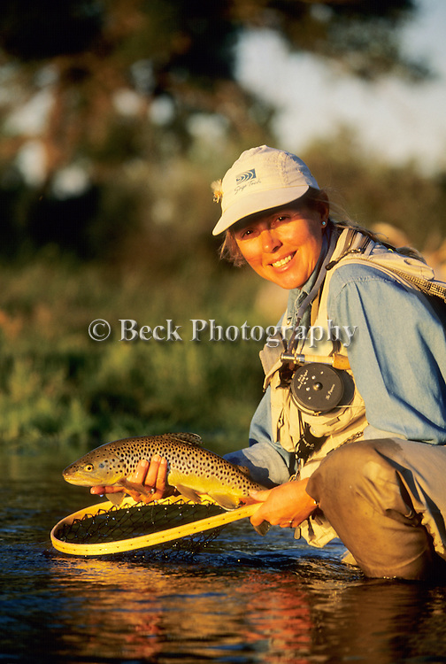 Cathy Beck with a brown trout from the Big Horn River, MT
