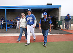 Wildcats' Kody Reynolds takes the field with his family during Sophomore Day ceremonies at Western Nevada College in Carson City, Nev., on Saturday, April 25, 2015. <br /> Photo by Cathleen Allison