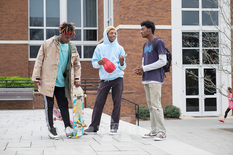 MSU student Lamarcus Walker with his skate boarding friends Jiordyn Sun and Zee Gandy outside Colvard Student Union.<br />  (photo by Megan Bean / &copy; Mississippi State University)