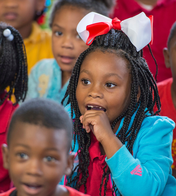 Students listen to a reading during a Touchdown Houston literacy program at NQ Henderson Elementary School, November 11, 2016.