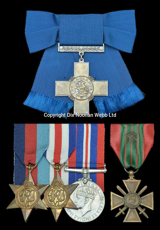 BNPS.co.uk (01202 558833)<br /> Pic: JanStarnes/DixNoonanWebb/BNPS<br /> <br /> Violette Szabό's awards: George Cross (top), (l-r) 1939-45 Star, France and Germany Star, 1939-45 War Medal, French Croix de Guerre.<br /> <br /> The world-famous gallantry medal awarded to a British secret agent who was one of the bravest women of World War II has today sold for a world record £312,000.<br /> <br /> The George Cross posthumously awarded to Violette Szabo, who was executed by the Nazis, was sold by her daughter Tania at a London auction.<br /> <br /> It was bought by Conservative peer Lord Ashcroft, who owns the world's largest collection of Victoria and George Crosses.